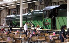 Swindon, A Swindon-built locomotive (Hagley Hall) on display in the eating area of the McArthur Glen Designer Outlet, Wiltshire © Maksim